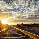 По железной дороге